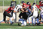 Palos Verdes, CA 11/10/10 - Billy Delpit (Peninsula #81), Matt Lopes(Palos Verdes # 29) and Brandon Chang (Palos Verdes # 35) in action during the junior varsity football game between Peninsula and Palos Verdes at Palos Verdes High School.