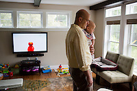 Fred Bermont holds son Dylan Bermont (age 9 months) in their home in Lexington, Massachusetts, USA, before he goes to work and drops the kids off at day-care on June 9, 2014. Bermont is the father of two children and shares parenting duties with his wife, Jen Bermont. Fred usually takes care of the morning routine, including feeding, dressing, and dropping the kids off at day-care, and Jen picks them up and watches over them in the afternoon. Fred is a Senior Clinical Standards Specialist at Shire, a pharmaceutical company with headquarters in Lexington.