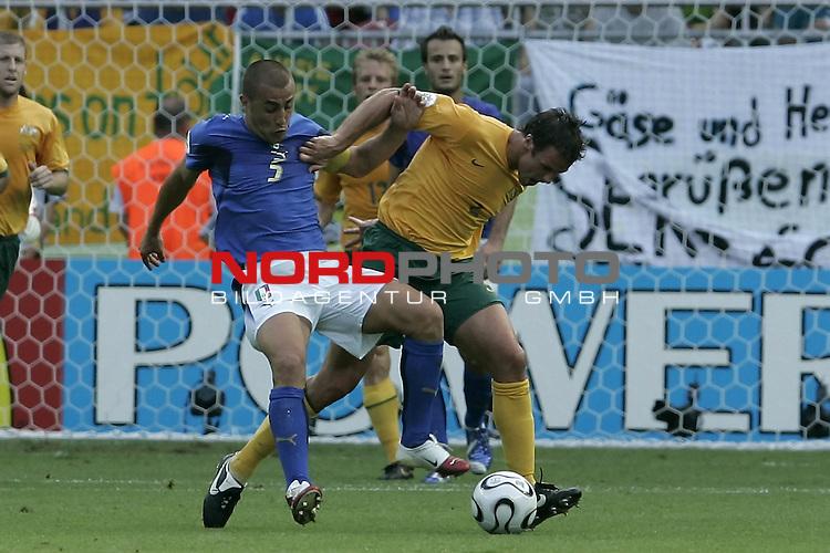 FIFA WM 2006 -  Round of Sixteen - / Viertelfinale <br /> Play      #53 (26-Jun) - Italien - Australien<br /> <br /> CANNAVARO-NEILL<br /> <br /> <br /> Foto &copy; nordphoto