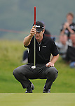 Scott Strange eyes up his putt on the 2nd. Celtic Manor Wales Open 2008 © IJC Photography 2008, iancook@ijcphotography.co.uk..