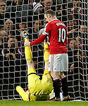 Wayne Rooney of Manchester United grabs the legs of a stranded Thibaut Courtois of Chelsea - English Premier League - Manchester Utd vs Chelsea - Old Trafford Stadium - Manchester - England - 28th December 2015 - Picture Simon Bellis/Sportimage