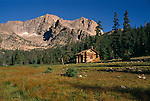 A rustic cabin sits beneath Mt Alice near Thunder Lake in Rocky Mountain National Park, CO