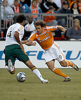 Houston Dynamo midfielder Brian Mullan tries to dribble around Los Angeles Galaxy defender Ante Jazic (4).  Houston Dynamo and Los Angeles Galaxy played to a 0-0 tie at Robertson Stadium in Houston, TX on April 8, 2007.