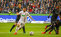 Marco Richter (FC Augsburg) setzt sich durch gegen Makoto Hasebe (Eintracht Frankfurt), Evan N'Dicka (Eintracht Frankfurt),und erzielt das Tor zum 1:1 - 14.04.2019: Eintracht Frankfurt vs. FC Augsburg, Commerzbank Arena, 29. Spieltag DISCLAIMER: DFL regulations prohibit any use of photographs as image sequences and/or quasi-video.
