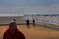 People playing boules on the beach next to the white beach huts on the Promenade des Regates, with view over the English Channel, at Le Havre, Normandy, France. Picture by Manuel Cohen