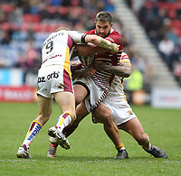 Wigan Warriors' Romain Navarrete is tackled by Huddersfield Giants' Ryan Hinchcliffe (left) and Sam Rapira <br /> <br /> Photographer Stephen White/CameraSport<br /> <br /> Betfred Super League Round 5 - Wigan Warriors v Huddersfield Giants - Sunday 19th March 2017 - DW Stadium - Wigan<br /> <br /> World Copyright &copy; 2017 CameraSport. All rights reserved. 43 Linden Ave. Countesthorpe. Leicester. England. LE8 5PG - Tel: +44 (0) 116 277 4147 - admin@camerasport.com - www.camerasport.com