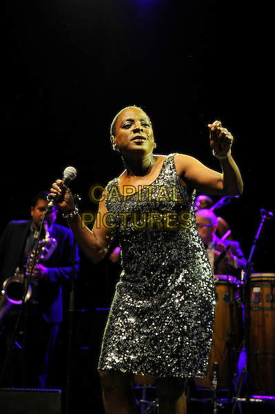 LONDON, UK, JUNE 27: Sharon Jones of Sharon Jones and the Dap Kings performing as part of the Daptone Records Super Soul Revue concert at Shepherd's Bush Empire on June 27th 2014.<br /> CAP/MAR<br /> &copy; Martin Harris/Capital Pictures