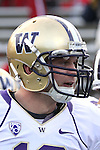 Jake Locker (#10), University of Washington quarterback, shown during the Huskies Pac-10 conference football game against arch-rival Washington State at Martin Stadium in Pullman, Washington, on December 4, 2010.  Washington scored a touchdown in the final minute of play in their annual Apple Cup battle to pull out a victory, 35-28.