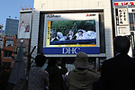 People watch a large screen broadcasting Japanese Emperor Naruhito's enthronement parade in Tokyo, Japan on Sunday, November 10, 2019. (Photo by Hiroyuki Ozawa/AFLO)