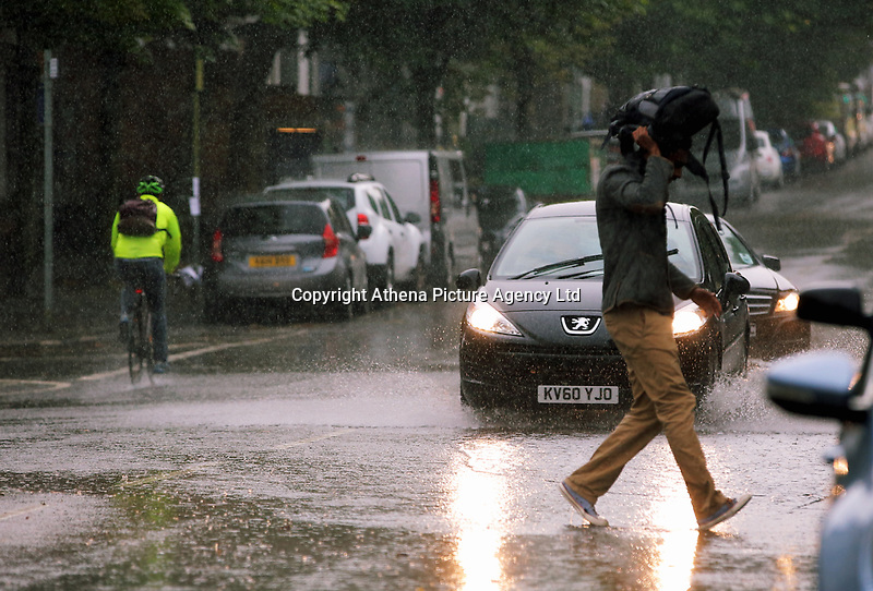 WEATHER PICTURE WALES<br />Cars drive through a paddle in Walter Road during a sudden downpour in the city centre of Swansea, Wales, UK. Friday 15 September 2017