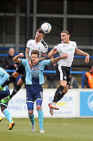 Andy Monkhouse of Grimsby Town (11) in an aerial battle during the Vanarama National League match between Dover Athletic and Grimsby Town at the Crabble Athletic Ground, Dover, England on 16 April 2016. Photo by Tony Fowles/PRiME Media Images.