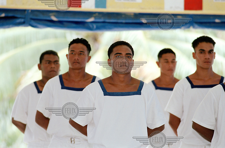 Graduating seafarers stand to attention as their compatriots receive graduation certificates to acknowledge their achievements.  The graduates will leave Tuvalu to work with international shipping agents abroad and send back a percentage of their remittances to their families...