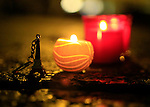 An Eiffel Tower key ring is seen with candles on November 15, 2015 at a makeshift memorial in Trento, North Italy, for the victims of November 13 attacks in Paris. <br /> Islamic State jihadists claimed a series of coordinated attacks by gunmen and suicide bombers in Paris that killed at least 132 people in scenes of carnage at a concert hall, restaurants and the national stadium.