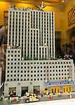 Manhattan, New York, U.S. - May 21, 2014 - In Times Square, the Lego store has Lego Miniland with a recreation of Radio City Music Hall in its window display, during a pleasant Spring day in Manhattan. The buildings are made from Lego building blocks.