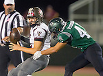 Torrance, CA 10/09/15 - Ryan Carroll (Torrance #2) and Sean Fitzgerald (South #42) in action during the Torrance vs South High varsity football game.  South defeated Torrance 24-21.