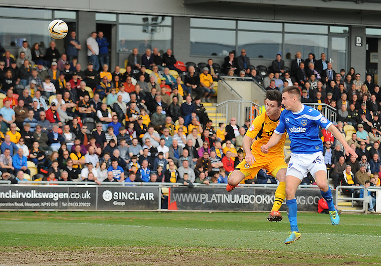 Portsmouth's Jed Wallace scores his sides second goal <br /> <br /> Photo by Kevin Barnes/CameraSport<br /> <br /> Football - The Football League Sky Bet League Two - Newport County AFC v Portsmouth - Saturday 29th March 2014 - Rodney Parade - Newport<br /> <br /> &copy; CameraSport - 43 Linden Ave. Countesthorpe. Leicester. England. LE8 5PG - Tel: +44 (0) 116 277 4147 - admin@camerasport.com - www.camerasport.com