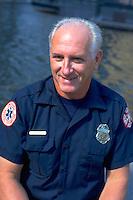 Paramedic age 50 happily sitting near fountain. Exchange Charities Youth Festival Minneapolis  Minnesota USA