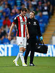 Richard Stearman of Sheffield Utd goes off injured during the Championship match at the Cardiff City Stadium, Cardiff. Picture date: August 15th 2017. Picture credit should read: Simon Bellis/Sportimage