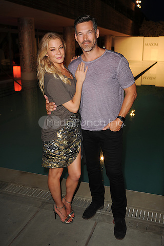 MIAMI BEACH , FL - JULY 18: LeAnn Rimes and Eddie Cibrian at the Maxim runway show during Miami Fashion Week 2015 at the SLS Hotel on July 18, 2015 in Miami Beach, Florida. Credit: mpi04/MediaPunch