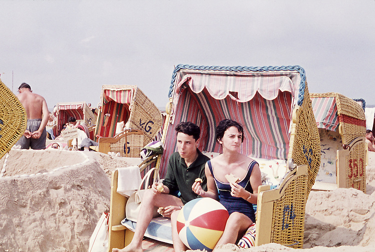 Europe, DEU, Germany, Sylt Island, In the sixties, Historical image, People, Pair at the beach, Beach Chair, Ball, Swimming Area, Woman and Man, Historic image from the sixties., Tourism Touristic, Tourist, Travel, Traveller, Journey, Voyage, Holiday, Holidays, Tourist country, Hystory, Historic, Historical, Historical image, Historical photography, Contemporary, Historic image, Historic photography....Europa, DEU, Deutschland, Insel Sylt, 60er Jahre, Historische Aufnahme, Paar im Strandkorb, Reisen und Urlaub in den 60er Jahren. Historische Fotografie die in den 60er Jahren entstand und den Zeitgeist der damaligen Zeit symbolisiert., Tourismus, Touristik, Touristisch, Urlaub, Reisen, Reisen, Ferien, Urlaubsreise, Freizeit, Historisch, Geschichte, Geschichtliches, Historische Aufnahme, Historische Fotografie....[For each utilisation of my images my General Terms and Conditions are mandatory. Usage only against use message and proof. Download of my General Terms and Conditions under http://www.image-box.com or ask for sending. A clearance before usage is necessary. Material is subject to royalties. Each utilisation of my images is subject to a fee in accordance to the present valid MFM-List. Contact: Uwe Schmid-Photography, Duisburg, Germany, Tel. (+49).2065.677997,..schmid.uwe@onlinehome.de, www.image-box.com]