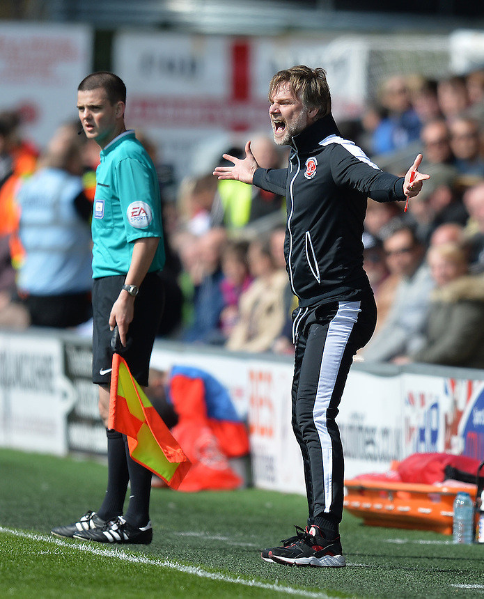 Fleetwood Town's Manager Steven Pressley shouts instructions to his team from the dug-out<br /> <br /> Photographer Dave Howarth/CameraSport<br /> <br /> Football - The Football League Sky Bet League One - Fleetwood Town v Blackpool - Saturday 23rd April 2016 - Highbury Stadium - Fleetwood  <br /> <br /> &copy; CameraSport - 43 Linden Ave. Countesthorpe. Leicester. England. LE8 5PG - Tel: +44 (0) 116 277 4147 - admin@camerasport.com - www.camerasport.com