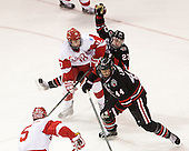 Danny O'Regan (BU - 10), Colton Saucerman (NU - 23), Dax Lauwers (NU - 44) - The Boston University Terriers defeated the visiting Northeastern University Huskies 5-0 on senior night Saturday, March 9, 2013, at Agganis Arena in Boston, Massachusetts.