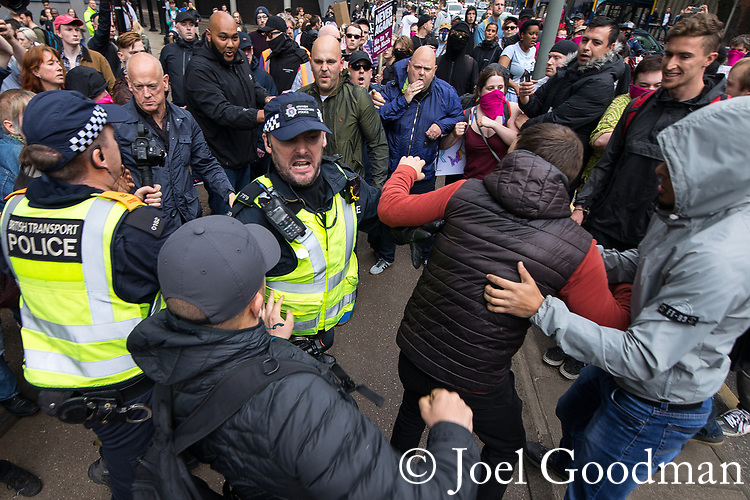 "© Joel Goodman - 07973 332324 . 11/06/2017 . Manchester , UK . Fights break out between the demonstrators and anti fascists . Demonstration against Islamic hate , organised by former EDL leader Tommy Robinson's "" UK Against Hate "" and opposed by a counter demonstration of anti-fascist groups . UK Against Hate say their silent march from Piccadilly Train Station to a rally in Piccadilly Gardens in central Manchester is in response to a terrorist attack at an Ariana Grande concert in Manchester , and is on the anniversary of the gun massacre at the Pulse nightclub in Orlando . Photo credit : Joel Goodman"