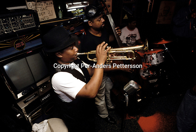 A Jazz band performing at a club on October 22, 1998 in the French Quarter in New Orleans, USA. People from all over the world comes to New Orleans to enjoy music, good food and lax laws on drinking alcohol in public..(Photo: Per-Anders Pettersson/Getty Images).