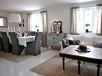 The dining room is decorated in soft earthy colours and furnished with a mix of nostalgic and modern furniture