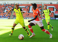Blackpool's Bright Osayi-Samuel under pressure from Exeter City's Craig Woodman<br /> <br /> Photographer Kevin Barnes/CameraSport<br /> <br /> Football - The EFL Sky Bet League Two - Blackpool v Exeter City - Saturday 6th August 2016 - Bloomfield Road - Blackpool<br /> <br /> World Copyright © 2016 CameraSport. All rights reserved. 43 Linden Ave. Countesthorpe. Leicester. England. LE8 5PG - Tel: +44 (0) 116 277 4147 - admin@camerasport.com - www.camerasport.com