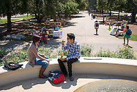 Students have lunch near the JSC fountain and Academic Quad on March 27, 2013. (Photo by Marc Campos, Occidental College Photographer)