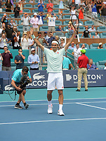 MIAMI GARDENS, FLORIDA - MARCH 31: Roger Federer of Switzerland defeats John Isner of USA in the final during day fourteen of the Miami Open tennis on March 31, 2019 in Miami Gardens, Florida. <br /> <br /> <br /> People: Roger Federer