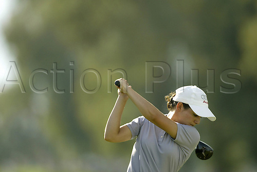 26 March 2004: Mexican golfer Lorena Ochoa (MEX) drives off during the second round of the Kraft Nabisco Championship at Mission Hills CC in Rancho Mirage, CA, USA. Photo: Darren Caroll/actionplus...040326.woman lady ladies female golf sand trap