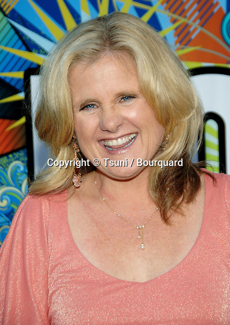 Nancy Cartwright arriving at the tca ( television critic association )  FOX Summer party on the Santa Monica Pier in Los Angeles.<br /> <br /> headshot<br /> eye contact<br /> smile