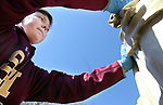 WATERBURY CT. 16 March 2018-031919SV07-Sacred Heart High student, DJ Gereski, 15, of Watertown, helps to clean the St. Joseph statue at the St. Joseph Cemetery in Waterbury Tuesday. Tuesday March 19th was St. Joseph Day. <br /> Steven Valenti Republican-American