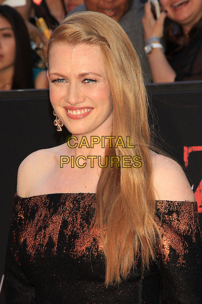 Mireille Enos<br /> The New York Premiere of &quot;World War Z&quot; in Times Square, New York, NY., USA.<br /> June 17th, 2013<br /> headshot portrait black red orange off the shoulder pattern   <br /> CAP/LNC/TOM<br /> &copy;LNC/Capital Pictures