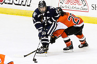 Yale's Tara Tominoto (4) looks for an open player as RIT's Erin Zach (20) tried to move in the third period. RIT defeated Yale 3-0 at Blue Cross Arena in Rochester, New York on October 20, 2012