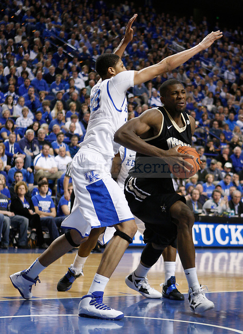 Anthony Davis guards a Vanderbilt player during the first half of the game in  Rupp Arena on Saturday, Feb. 25, 2012. Photo by Latara Appleby | Staff ..