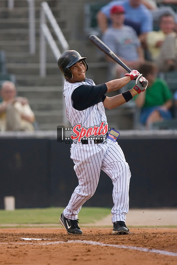 Oney Guillen (22) of the Kannapolis Intimidators follows through on his swing at Fieldcrest Cannon Stadium in Kannapolis, NC, Wednesday August 21, 2008. (Photo by Brian Westerholt / Four Seam Images)