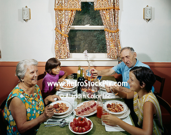 Family having a meal in the Otis View Manor dining room.