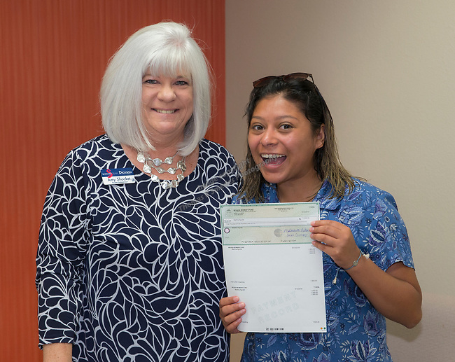 Martha Aguilar, right, and Board Member Amy Shocket during the Nevada Women's Fund Scholarship distribution, June 20, 2019.
