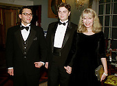 Actress Mia Farrow, right, poses with her sons Fletcher and Lukas at the 1998 Kennedy Center Honors Dinner at the Department of State in Washington, DC. on December 5, 1998.  Each year the Kennedy Center Honors celebrate the lifetime achievements of America's greatest performing artists with a star-studded evening of song, dance, and tribute.   .Credit: George De Keerle - Pool / CNP