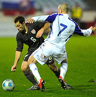 Steve Cherundolo (6) battles for possession against Vladimir Weiss (7). Slovakia defeated the US Men's National Team 1-0 at the Tehelne Pole in Bratislava, Slovakia on November 14th, 2009.