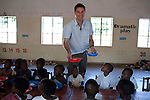 Mcc0039986 . Daily Telegraph..Magnus MacFarlane-Barrow ceo of Mary's Meals feeding children at the Namasemba Under Six Centre in Blantyre, Malawi where his Charity feeds 151 orphans and vulnerable children six days a week ..Mary's meals feeds over 500,000 children in Malawi and over 600,000 children worldwide. Malawi is one of the poorest countries in the world and the concept behind Mary's Meals is to provide a daily meal in a place of education, attracting chronically poor children to the classroom where they can gain a basic education that could one day provide an escape route out of poverty. ..Malawi 20 May 2012.