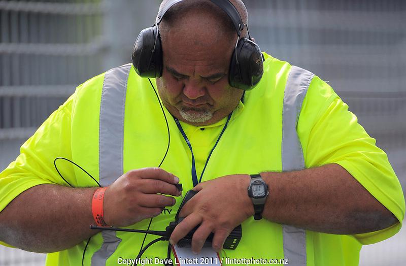 A marshall adjusts his earphones. V8 Supercars - ITM 400 at Hamilton Street Circuit, Hamilton, New Zealand on Friday, 15 April 2011. Photo: Dave Lintott / lintottphoto.co.nz