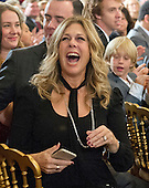 Actress Rita Wilson cheers as her husband, actor and filmmaker Tom Hanks, arrives to accept Presidential Medal of Freedom, the Nation's highest civilian honor, from United States President Barack Obama in the East Room of the White House in Washington, DC on November 22, 2016.<br /> Credit: Ron Sachs / CNP