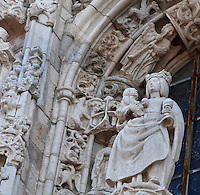Statue of Santa Maria de Belem on a pedestal above the archivolt, surrounded by statues under canopies, on the South Portal, 1516-18, by Joao de Castilho, 1470ñ1552, after a design by Diogo de Boitaca, Church of Santa Maria, at the Jeronimos Monastery or Hieronymites Monastery, a monastery of the Order of St Jerome, built in the 16th century in Late Gothic Manueline style, Belem, Lisbon, Portugal. The portal consists of double doors with a tympanum carved with scenes from the life of St Jerome, a statue of Henry the Navigator, many carved statues in niches, a statue of the Madonna and many flamboyant pinnacles and gables in Manueline style. The monastery is listed as a UNESCO World Heritage Site. Picture by Manuel Cohen