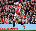 Alexis Sanchez of Manchester United leaps up and chests the ball under control during the premier league match at the Old Trafford Stadium, Manchester. Picture date 15th April 2018. Picture credit should read: Simon Bellis/Sportimage
