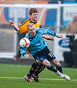 Forfar's Jordan Brown is caught by Alloa's Ryan McCord.