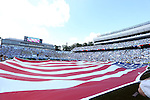 24 September 2016: UNC's dance team holds a large American flag during the playing of the national anthem. The University of North Carolina Tar Heels hosted the University of Pittsburgh Panthers at Kenan Memorial Stadium in Chapel Hill, North Carolina in a 2016 NCAA Division I College Football game. UNC won the game 37-36.
